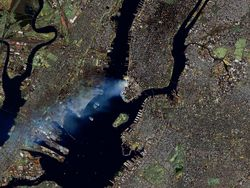 [September 11 from space: Manhattan spreads a large smoke plume (NASA)]