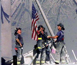 [World Trade Center site, fire man raise U.S. flag]